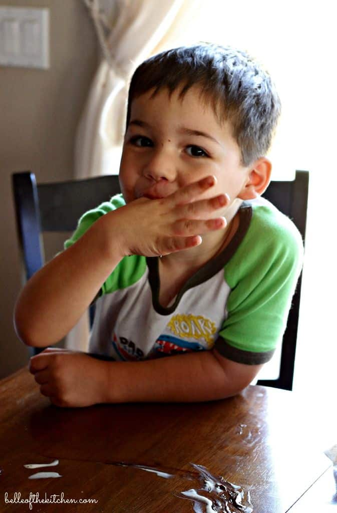 A little boy sitting at a table
