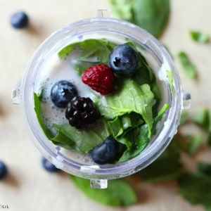 a berry smoothie with spinach
