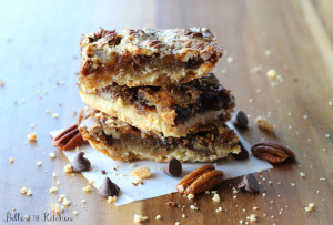 a stack of chocolate pecan pie bars