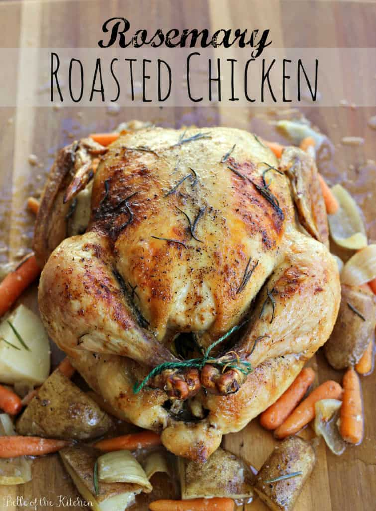 a roasted whole chicken with veggies on the side
