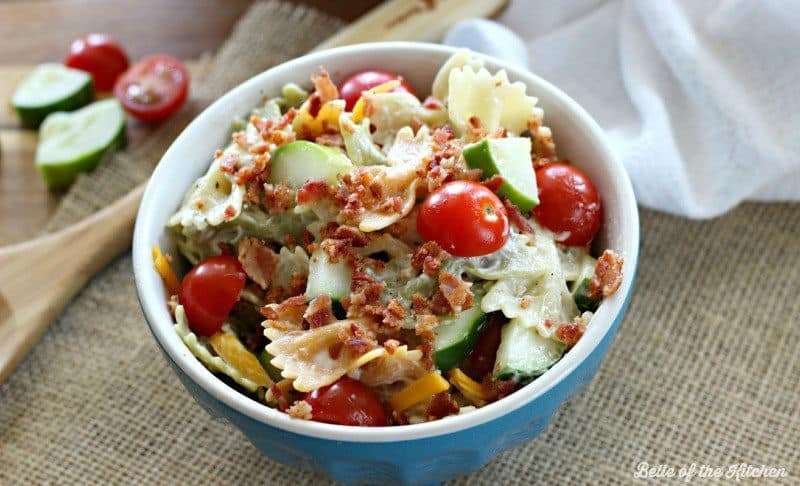 A bowl of pasta salad with veggies