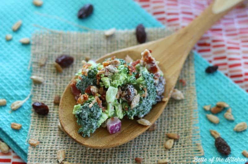 a spoon full of broccoli salad