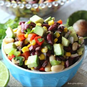 A bowl of bean salad with diced avocado