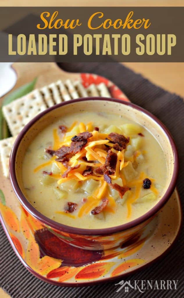 A bowl of potato soup topped with cheese and bacon