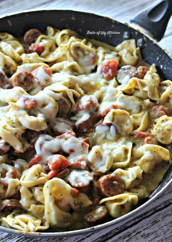 A pan filled with sausage and tortellini