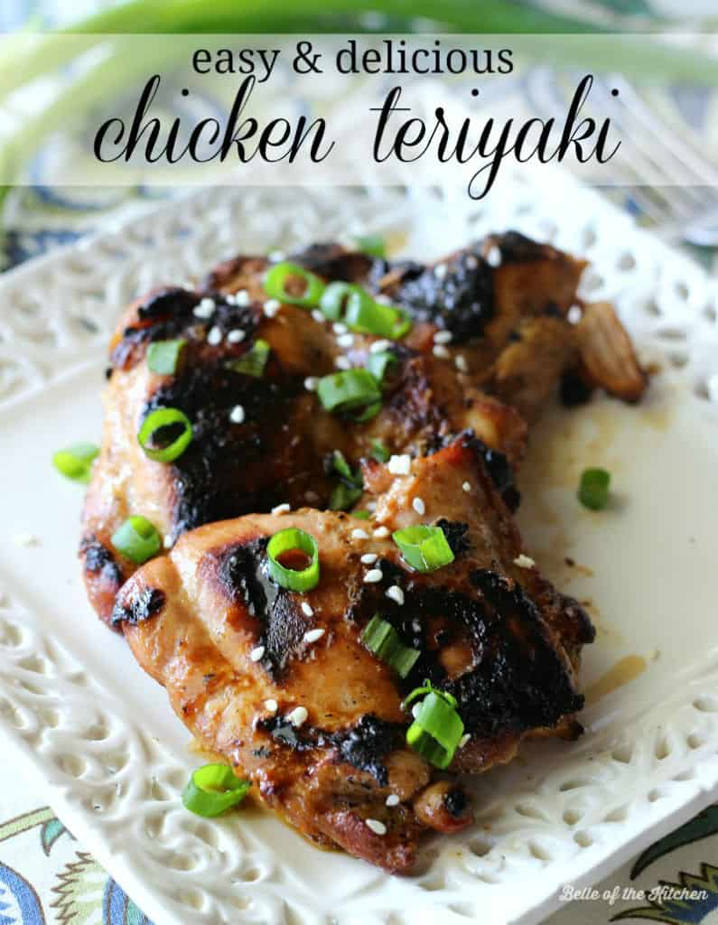 A close up of grilled chicken on a plate topped with green onions