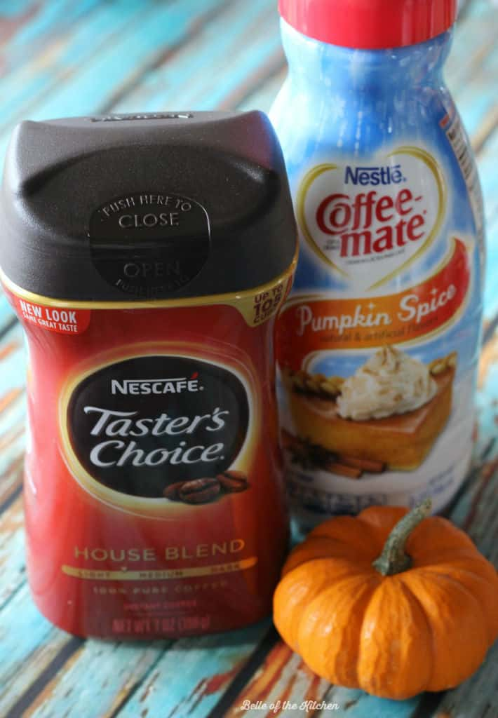 a package of coffee next to a container of pumpkin creamer