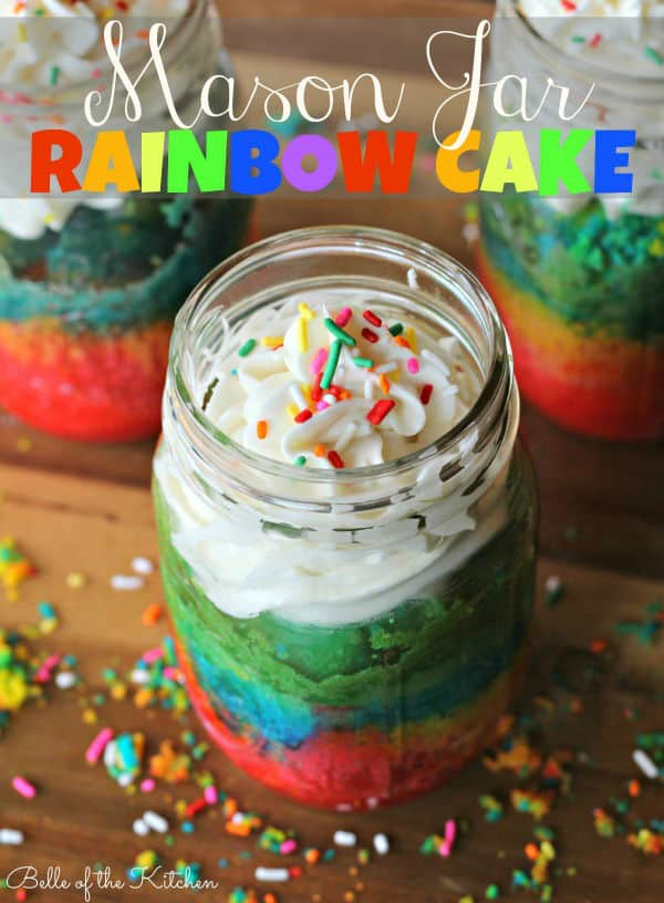 a mason jar filled with cake, frosting, and sprinkles