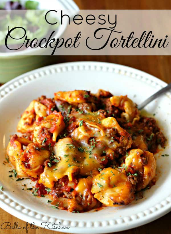 A plate of tortellini with a fork