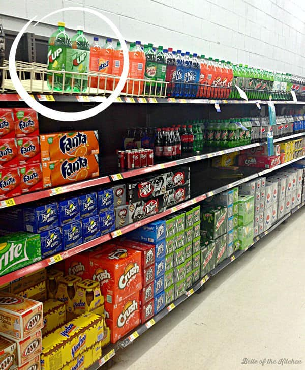 A store shelf full of soda