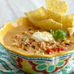 Peppers, onions, and creamy cheese come together to make this delicious Chicken Fajita Soup. Topped off with a little sour cream and chips on the side, this is a bowl of southwest comfort food!