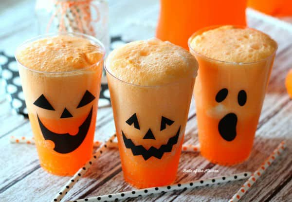 cups of Fanta and vanilla ice cream with jack o\' lantern faces