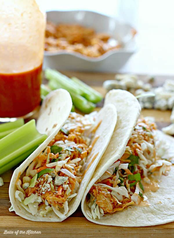 Juicy and delicious buffalo chicken cooked to perfection with the help of your crockpot. Stuff it into tortillas with a little coleslaw mix, blue cheese crumbles, and a drizzle of homemade Buffalo Ranch, and you have an easy and yummy dinner!