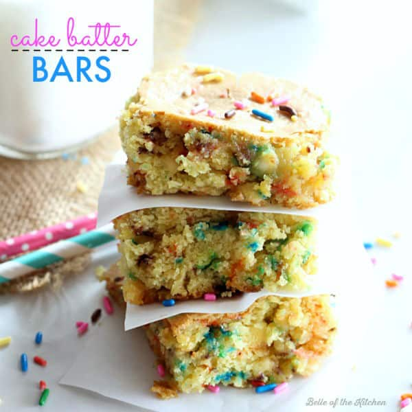 a stack of cake batter bars topped with colorful sprinkles