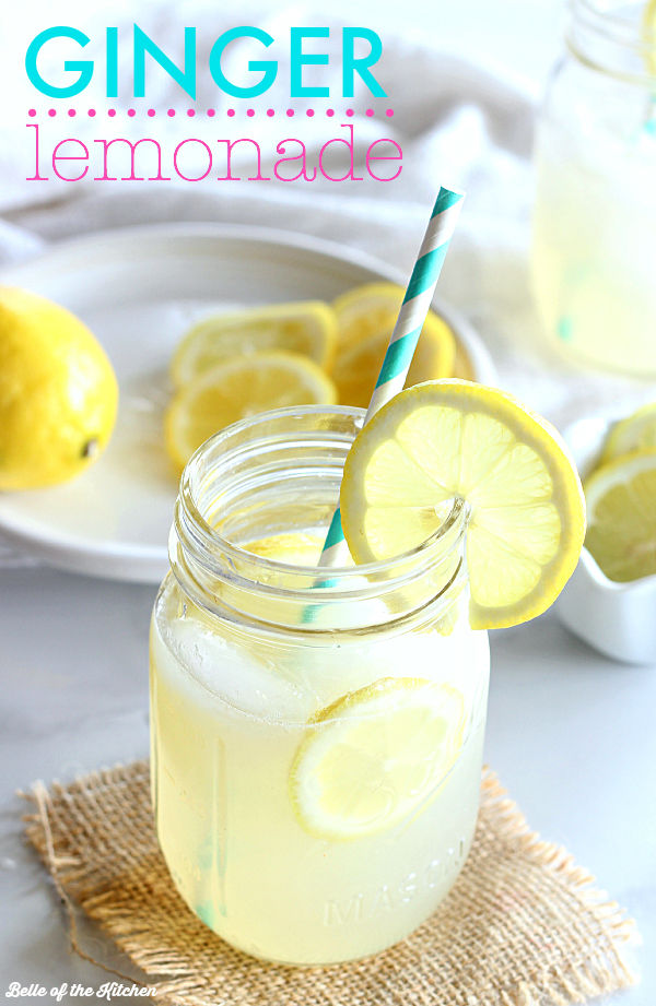 a glass of lemonade with a straw and lemon slice on the side
