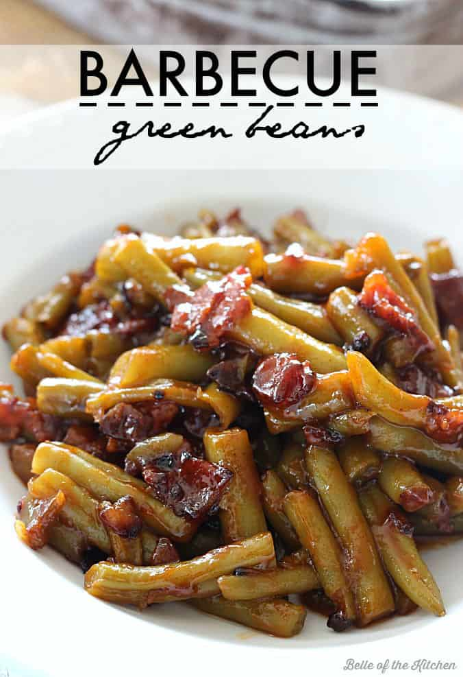 A plate of green beans with bacon and bbq sauce