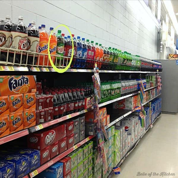 A store shelf of bottled soda