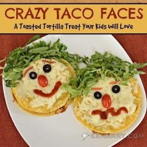 A close up of a plate of tacos with faces
