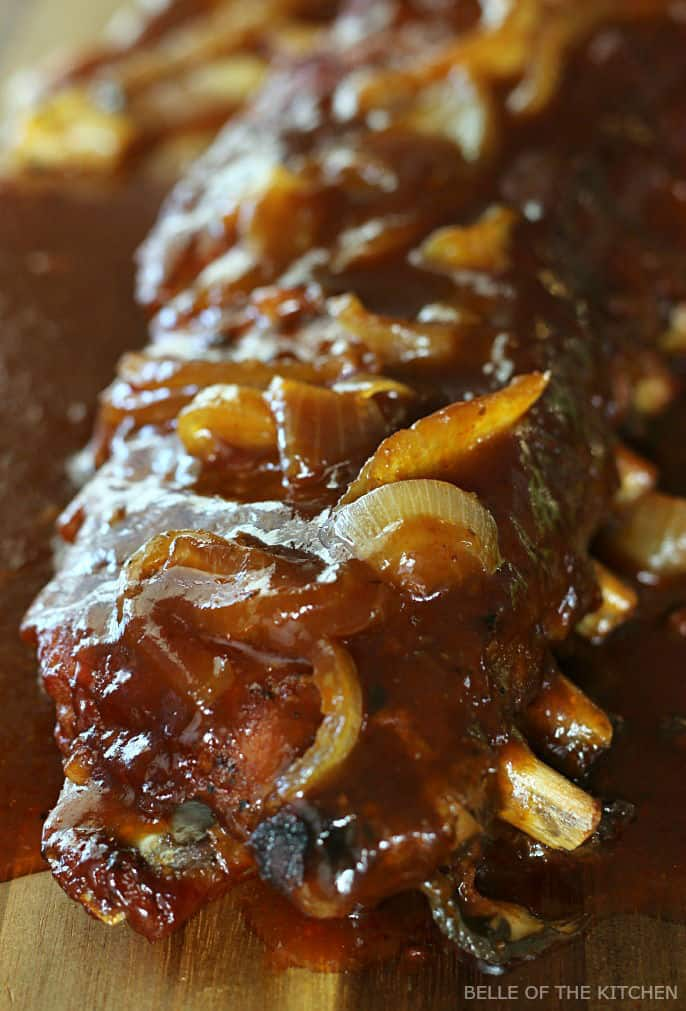 These Crockpot BBQ Ribs are deliciously easy! Made with a homemade rub, sliced onions, and barbecue sauce, these are seriously finger-lickin' good!