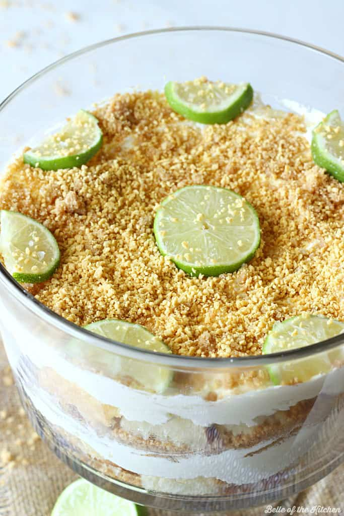 Key Lime Cheesecake Trifle - An easy and pretty dessert made with layers of graham cracker crust, cubed pound cake, and a key lime cheesecake filling.