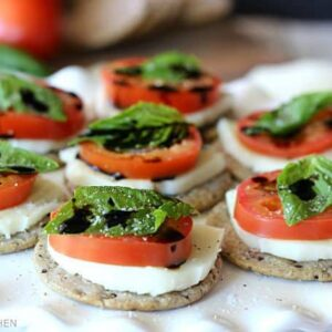 The easiest gluten free appetizer ever! Made with tomatoes, fresh mozzarella, basil, and a homemade balsamic reduction, all stacked on top of a Breton Gluten Free Black Bean and Herb cracker! So simple and SO good!