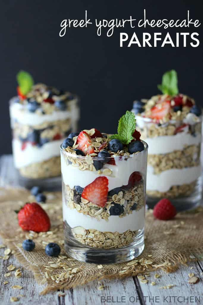 parfaits made of fruit, yogurt and granola, with mint on top inside of glasses