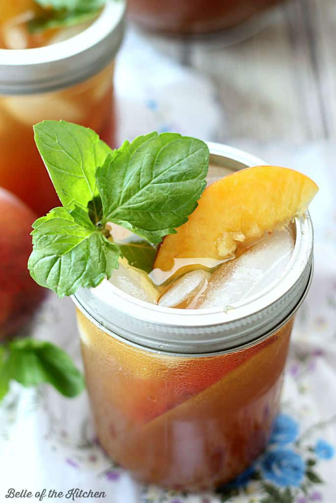 This Peach Sweet Tea combines two delicious southern flavors all in one glass! Fresh brewed tea is sweetened with simple syrup and pureed peaches, then served over ice for a cool, refreshing treat!