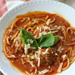 A bowl of Soup and Spaghetti