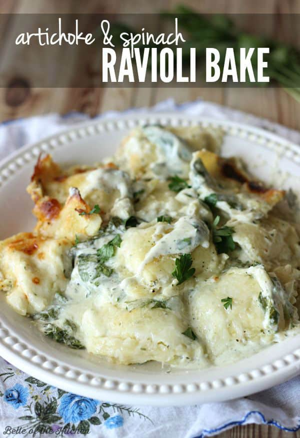 a plate of cheesy ravioli topped with parsley