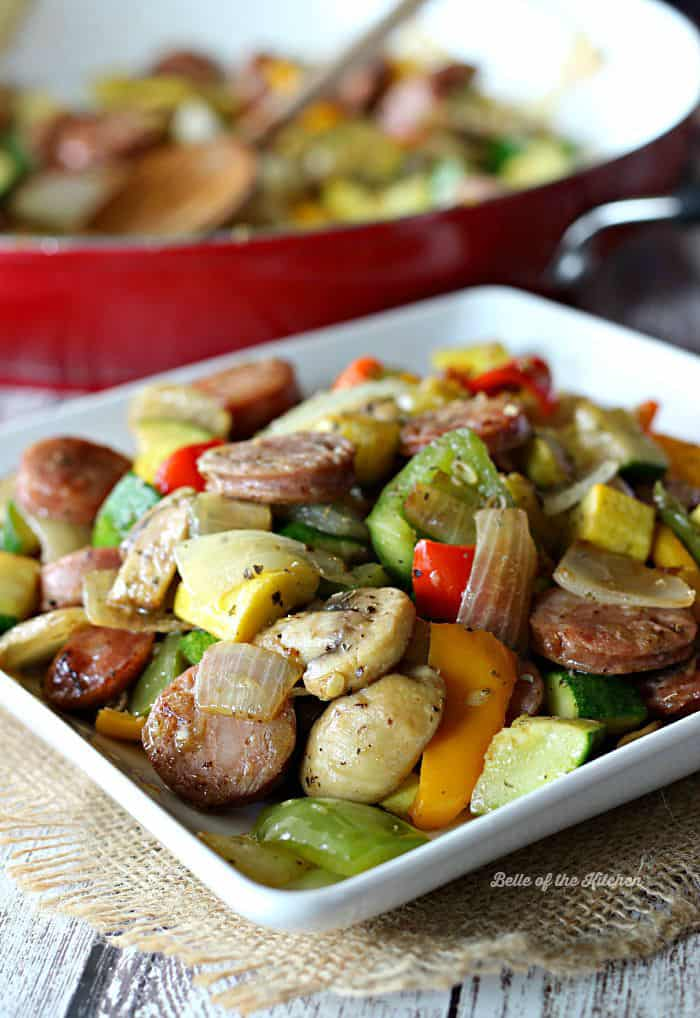 A plate filled with sausage and vegetables