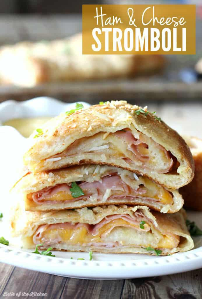 A close up of a stack of ham and cheese Stromboli