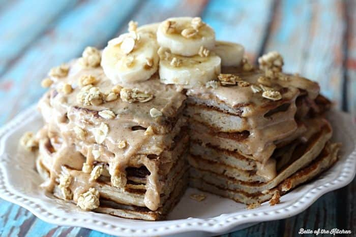Greek yogurt pancakes packed with protein and topped with an almond butter yogurt glaze.
