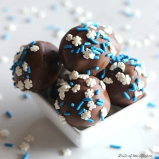 These Chocolate Cake Balls are made with crumbled cake and frosting, then dipped in melted chocolate and covered with sprinkles. The perfect easy treat!
