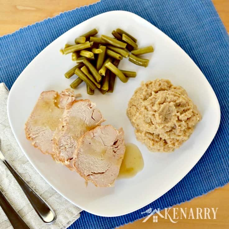 A plate of food turkey, green beans, and cauliflower