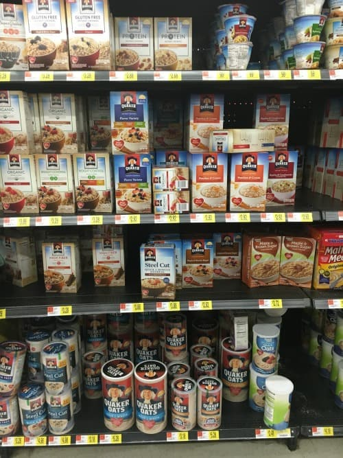 a store shelf with boxes of oatmeal