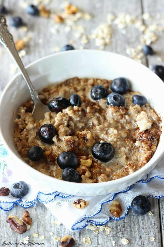 A bowl of oatmeal filled with blueberries