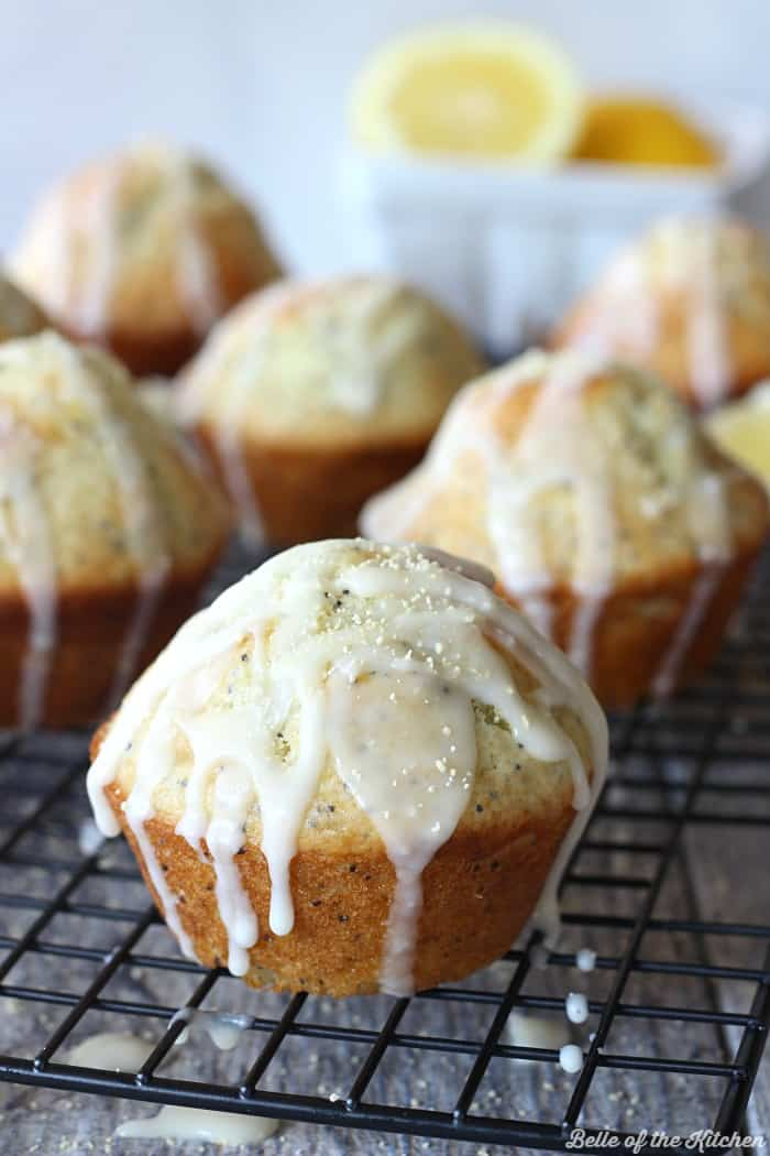 These Lemon Poppy Seed Muffins are bursting with sweet citrus flavor, and perfect for spring! They are finished with a drizzle of lemon glaze and Honey Granules on top.