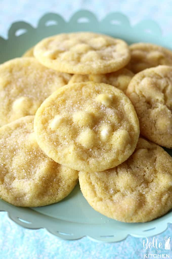 lemon cookies with white chocolate chips on a plate