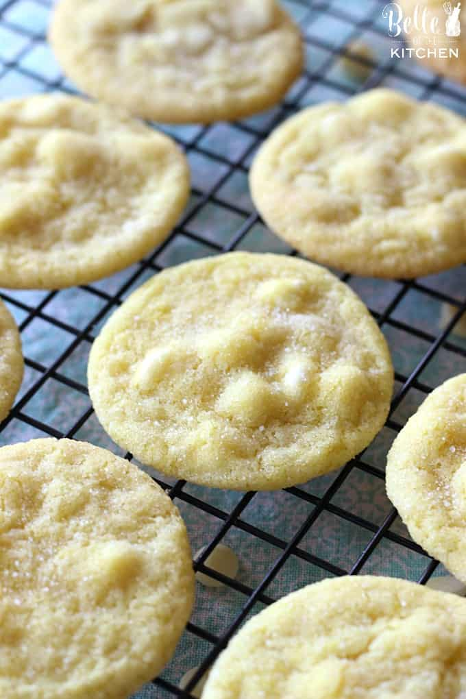 lemon cookies with white chocolate chips on a cooling rack
