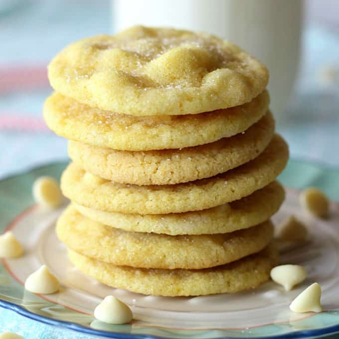 A close up of a stack of lemon cookies with white chocolate chips