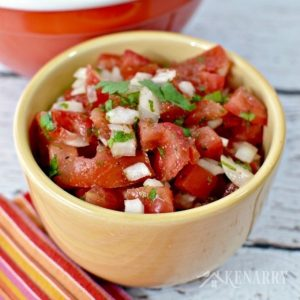 This homemade pico de gallo recipe is easy to make as an appetizer or snack idea for a party. It's a fresh salsa made with tomatoes, onions, cilantro and spices.