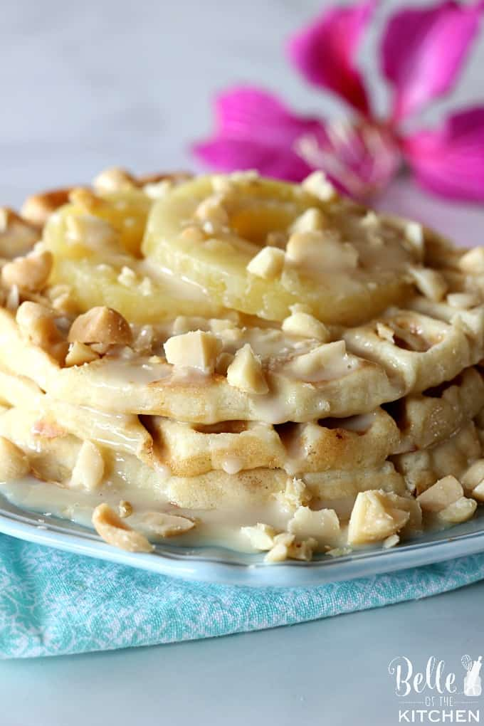 Pineapple Mac Nut Waffles - a tropical treat that's worth waking up for! Homemade waffles loaded with chopped pineapple, macadamia nuts, coconut, and more.