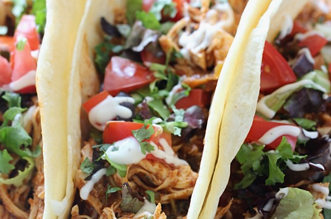 One of my favorite easy, slow cooker meals! Cilantro Lime Chicken Tacos made in the crockpot. And the ingredients are just dump and go!