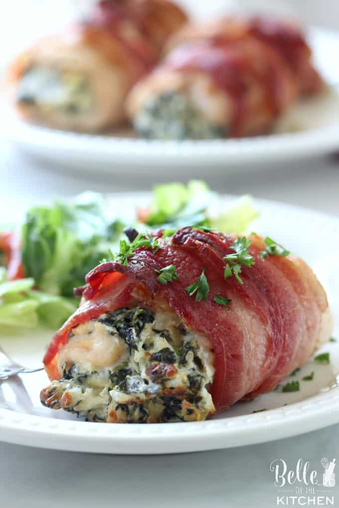 A close up chicken wrapped in bacon and filled with spinach