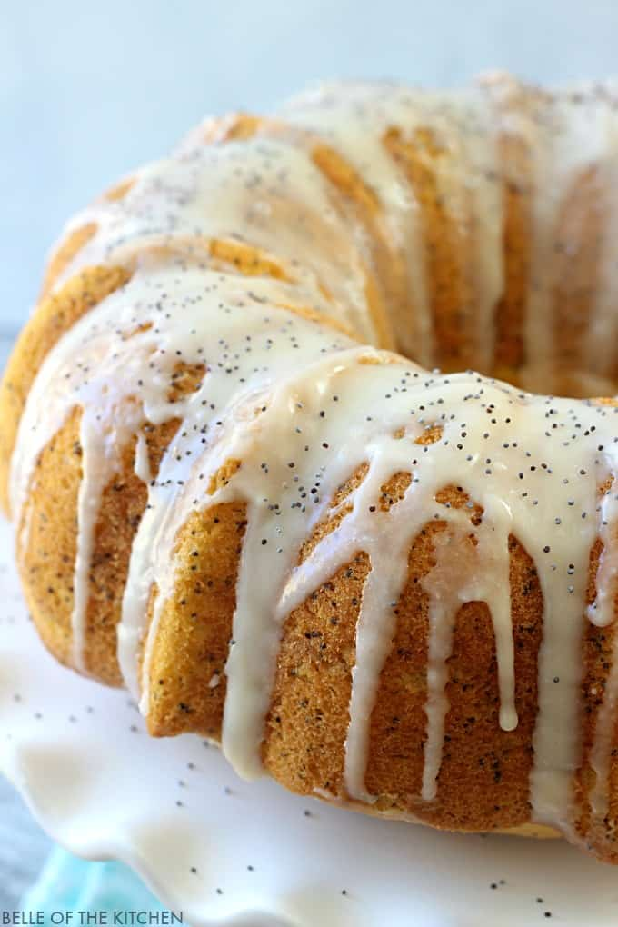 Lemon Poppy Seed Bundt Cake - a moist and delicious lemon cake bursting with crunchy poppy seeds and topped with a sweet lemon vanilla glaze.