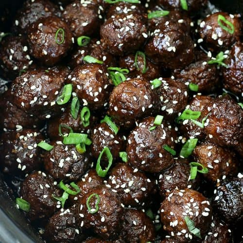 Crockpot Honey Sriracha Meatballs - yummy meatballs cooked in the crockpot in a tangy sauce with a kick of Sriracha. These make for an easy appetizer or a main dish served over rice!