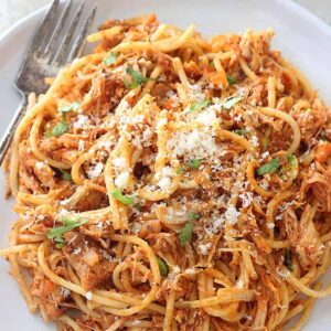 This Turkey Bolognese starts with a rich and hearty sauce and is paired with cooked turkey for a quick and delicious dinner that tastes gourmet! It's perfect for using up your leftover holiday turkey!