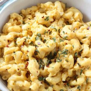 A dish is filled with food, with Cheese and Macaroni