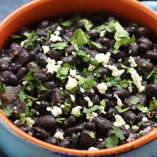 These Mexican Black Beans are my go-to side dish for Taco Tuesday or when I make enchiladas. They are SO good and SO easy to make!
