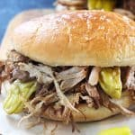 This Mississippi Pulled Pork is one of the easiest and most delicious recipes you can make with your crockpot! It's an amazing dump and go recipe that tastes so good served as a sandwich with mayo and a slice of melty cheese!